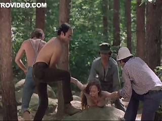 Four Saleable Lumberjacks Abuse Camille Keaton Outdoors In The Forest