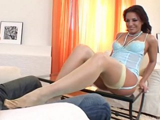 Beautiful legged hottie performing footjob