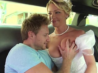 Bride at hand white beautiful dress gets drilled