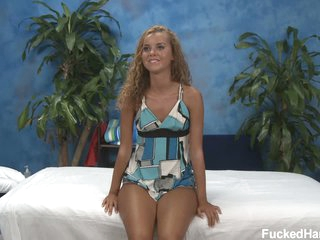 Cute tan skin girl Jessie in the massage room