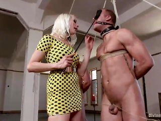Hot blonde mistress Lorelei has 3 slaves tied up with strings to every other and mouth gagged. While bawdy talking and playing with their nipples, she whips 'em and hurts their hard cocks. She rubs her tight ass to their dongs and laughs frenetically. They enjoy it so much and are desirous for more punishment!