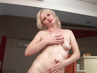 This mature golden-haired babe wearing only a pair of hawt pantyhose is ready for a lengthy fuck. She is in nature's garb in the living room and that babe is playing with her tiny round tits and with her shaved vagina. The bitch begins finger her tight vagina and that babe hopes her pussy will get a big cock very soon.