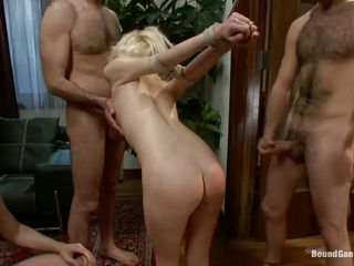 All these guys wish a piece of her ass but first they spank it until it turns red and fuck her nice-looking mouth roughly with their large cocks. The blonde cutie is tied up and at the mercy of these horny dudes! They fuck her one by one and humiliating and dominating her. Are we going to watch the blonde overspread in cum too