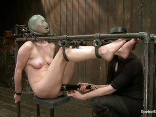Star heard about bdsm but she not ever thought that things could get so coarse in a session of bondage sadistic masochism. She was bound on that metal frame, a rubber balloon was used to cover her head and suffocate her and then clamps were used to gape her pussy. That was only the warm up, stick around and see more