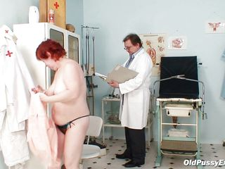 Redhead granny Tara is in the gynecologist room and that babe undress her clothes remaining totally naked. The doctor is inspecting her large tits and after that that guy takes a medical tool and inserts it in her tight ass hole. She seems like it and perhaps wonders how will it be if her doc will insert something larger in her anus.
