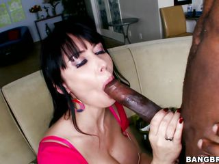 Busty milf Eva has a lust for big black cocks. She likes having a monster cock in her mouth but mostly this babe enjoys to fill her womb with one. After engulfing that pecker this babe takes a sit on the couch, raises these sexy legs and receives a deep hard fuck in her pussy. Fucking wench deserves it in the ass too!