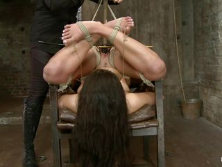 Scarlet, a 22 yo bitch is enjoying a comfortable chair and the soft touches of her mistress. Yep right! This floozy is tied up and with her ass up while mistress punishes her for being a naughty slut. She filled her pussy with a dildo and in the mean time rubbed her twat real hard with that vibrator. Enjoy!