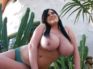 brunette milf showing her consequential bra buddies