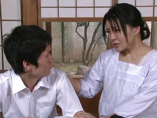 In a moment of compassion the mature Nippon lady strips and gives her body to this boy. He licks her mounds and then fingers her cunt as that babe shows him. Her delicious thighs are widen wide and his fingers slide faster and faster in her hairy vagina making her moan. Will that babe show him how to fuck her like man?