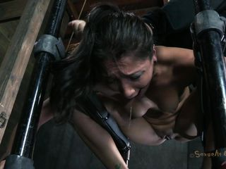 Positioned on a metal structure and tied with chains the lovely brunette hair Vicki is being face hole fucked by a guy. Her ass is damn hot and that pretty face hole of hers begs for cock and cum! The fellow shows her no lenience and stick his dick deep in her throat making her gag. That bald cum-hole could use the same treatment