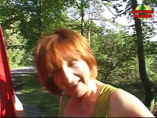 Yvonne is a sexy redhead mature that loves the outdoor, that's why when a blowjob opportunity appears, she takes it. She suck that ramrod like a pro, with no worries that someone else could drive on that road.
