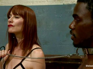 Alyssah Simone is a red head bitch who wants to punish this yielding black dudes for not following her orders. This babe puts a collar on his neck and swanks his ass. This babe makes him take off her heels and wants him to lick her pink cunt so she can enjoy his humiliation.