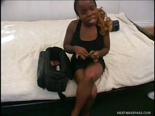 Black midget whore Cinnamon get's ready to suck 2 cocks. The guy put's a condom on his dick and then she adds some lube on it, making very slippery so she can take it all the way in her throat. We have a fun seeing her big juicy lips wrapping so perfectly around those big dicks and who knows, maybe she will get 'em in her ass too.