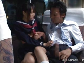 In that crowded bus everybody is tired and minds their own business but this schoolgirl is just barefaced and wants some action. She sees the guy and how he takes out his dick and then looks at it for a while before putting that hard rod in her mouth. The angel sucks him right there and everybody sees her
