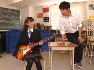 Nice-looking schoolgirl Asuka is in the classroom, learning to play the guitar. This slut is greater quantity interested in her professor and he sees in her a lot of potential but not as a guitar player. She has a lot greater quantity talent when it's about a hard dick and gives him one hell of a hand job before bending over in front of him
