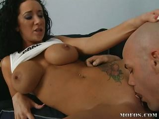 A hot brunette babe getting her pussy rammed by a tattooed dude on the sofa! Check out her pink taut getting all wonderful and moist before being tortured with pleasure from a hard cock!