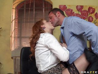 A very hot twenty four year old redhead tells David Perry that if he craves her to stay he will have to fuck her the way this babe wants. Look at her giant tits and her puffy nipps getting slapped and licked on the desk. Is this babe going to receive some cock in that tight cum-hole or some cum on those soaked lips?
