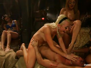 This guy is in a barn and he's surrounded by beautiful bitches that have their way with him while his girlfriend is made to watch. After this guy sucks some toes, the blond steps on his cock, making him hard before she rides him. Then another honey gets on his dick and goes for a ride. His girl looks on.