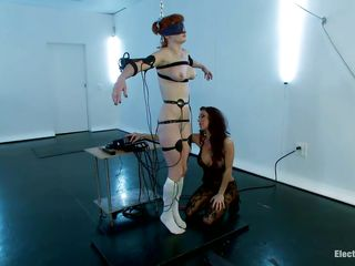 A sexy redhead with nice boobs and a hairless pussy is tied in front of this naughty brunette. Her body is covered with electrodes and she's getting some stimulation through them and also from that vibrator the brunette hair is using to rub her clitoris. Look at her groaning and receiving all the socking pleasures that babe wants.