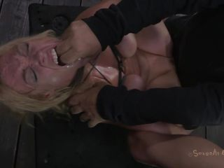 Tied up and with her legs spread this blonde experiences some hard fucking. The executor shows her no mercy and fucks her pussy unfathomable and hard whilst chocking her. This babe barely stands what this chab does and maybe a harder torture will make this blonde even more uncomplaining