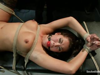 She's a brunette oriental floozy that the guy bound on a table and now he's having pleasure with her! Her big natural breasts with metal clamps on them are bouncing nicely as he drills her cunt with his ramrod and that pretty mouth of her look great ball gagged. Wonder if the guy will keep on fucking her vagina and then cum in it?