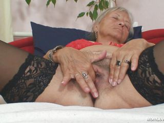 Horny granny Cecilie is ready to get some fun. This blonde bitch is naked on her bed and fingering her cookie with all of her fingers and rubbing her love button to make it wet. After that this whore takes a big dildo and she inserts it deep in her vagina.