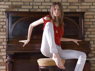 slender hotty with white pants on the piano
