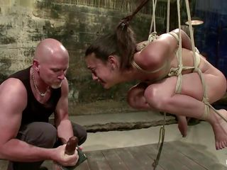 This chab likes punishing bad girls, that's why this girl is all tied up and hanging there while this guy inserts his penis unfathomable in her throat. After fucking her pretty throat the guy thinks that this is not enough for her and sticks a dildo in her pussy then proceeds the throat fucking. You indeed need to see what he's going to do with her next, trust me this won't be a waste of your time!