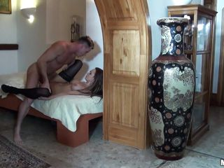 Steaming hot brunette chick in darksome nylons with biggest bra buddies and perfect ass is getting fucked on a bed in missionary position. She then gets on all fours and receives his dick from behind. On her knees, that babe gives the man a blow job and after that that babe is rammed once again. How will it end?
