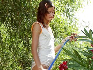 Natasha Shy is out in the garden, watering some flowers. The heat of the day and within receives to her and she begins hosing herself down! It receives even more intense as she drops to her knees and begins spraying the water directly on her slit and clit. She in a short time forgets about the flowers altogether!
