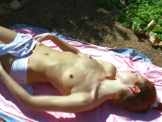 hot ass bitch masturbating while sunbathing