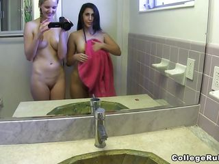 2 college chicks filming themselves in the bathroom's mirror. One of them is playing with her boobs taking a shower. Her boyfriend of the brunette one was waiting in her room. She is showing off her ass then she begins engulfing his dick. After that, they're filming themselves having sex.