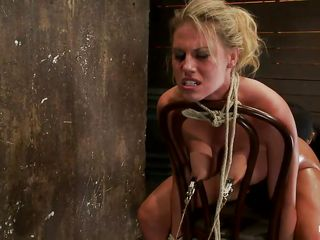 blond gives head while having a metal hook in her ass