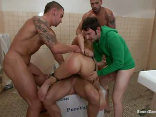 Toni, John, Tommy and Carlo teamed up against this blonde whore Lea Lexis. This busty whore is naked and screwed hardcore in the men's room. These guys with big dicks are filling her tight bald pussy in many positions as well as they're shoving their jocks in her mouth. And they didn't stop doing her in DP!