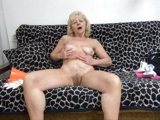 Granny needs to climax. She's horny and alone but this doxy has her dildo! That babe takes a sit on the couch, makes herself comfortable and then widens her thighs as wide as she can. Then, the old whore slowly inserts the vibrator in her saggy cunt and moans with delight. Enjoy yourself granny and be careful at those hips!