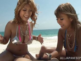 I deserve a break and this vacation was everything I always dreamed off. Here I am on the beach with 2 hot asian angels that are giving my dick a nice rubbing with their boobs. What the hell could I want more except seeing them how they play with my sperm on those big soft breasts. I got it on tape so watch it!