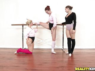 three elegant ballerinas having joke draw up