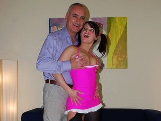 A hotty in a pink dress and black stockings enters the room where Jim Slip is awaiting for her.  She shows her arse and pussy to the camera. She acquires across Jim's knees to get spanked and then she gives him a blow job before he fucks her.