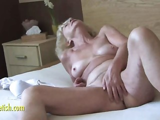 Granny Eva masturbation and fingering unshaved pussy
