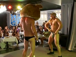 Lovely spectators are having fun engulfing male stripper's dick