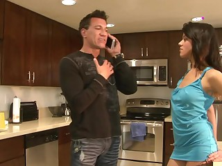 A sexy bitch is getting her butt fucked in the kitchen
