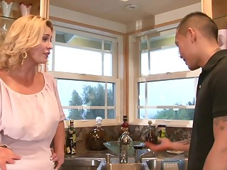 A blonde milf is getting her pussy spread open to the kitchen