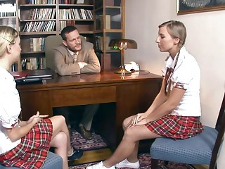 Two sexy teen bitches are procurement fucked in a hot threesome