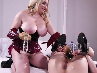A blonde dominates her brunette of a male effeminate friend with sexual congress toys
