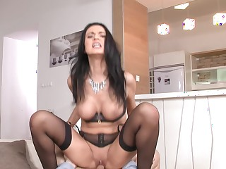 Busty brunette with hot lingerie is sitting on a dick really well
