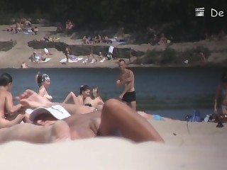 Nudist girl is lying showing the stretched slit to public