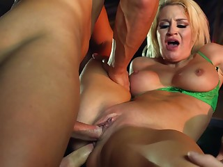 A bimbo with a XXX surrounding aggravation is receiving a double penetration