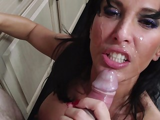A fat ass milf is getting fucked in the kitchen and she is in addition sucking