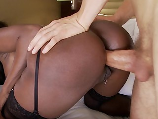 A huge ass black chick with large tits is getting anally fucked