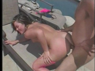 The enchanting Ashley Blue enjoys her sunbathing beside the pool. She's enjoying it so much that she brings her dildo along with her so that she can play with her pussy whilst being under the sun. Fortunate for her, a horny stud sees her and asks her if s